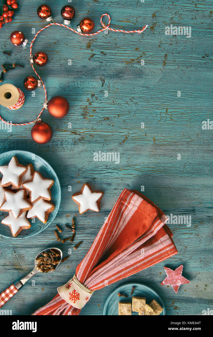 christmas background in red and white on rustic turquoise wood top view on christmas cookies spices and decorations toned image text space - Red White And Turquoise Christmas Decor