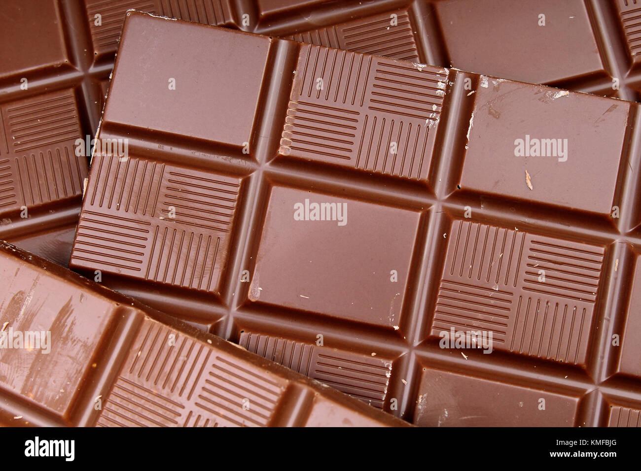 Chocolate Bars As Background Milk And Dark Shiny Chocolate Texture