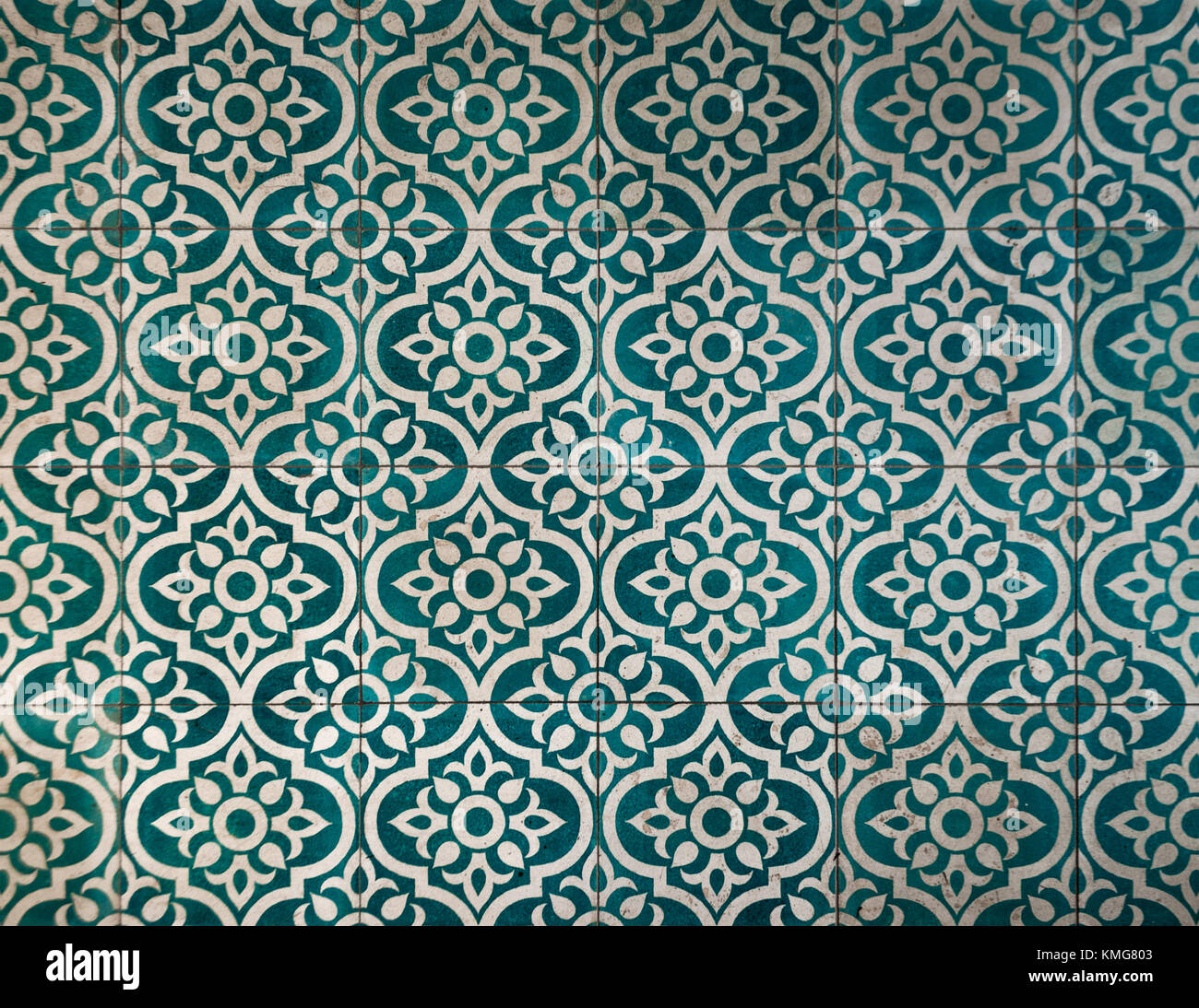 Ancient dark greenish blue and white tile pattern warn of buy time ...