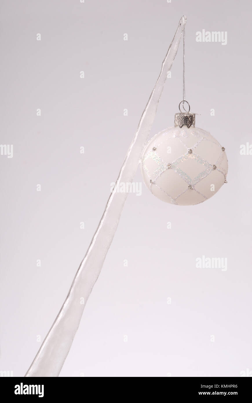 Icicle with a Christmas tree toy isolated on a grey background Stock ...