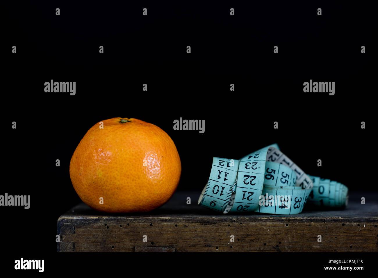 Tasty Mandarin On An Old Dark Wooden Kitchen Table Tailor S Measure