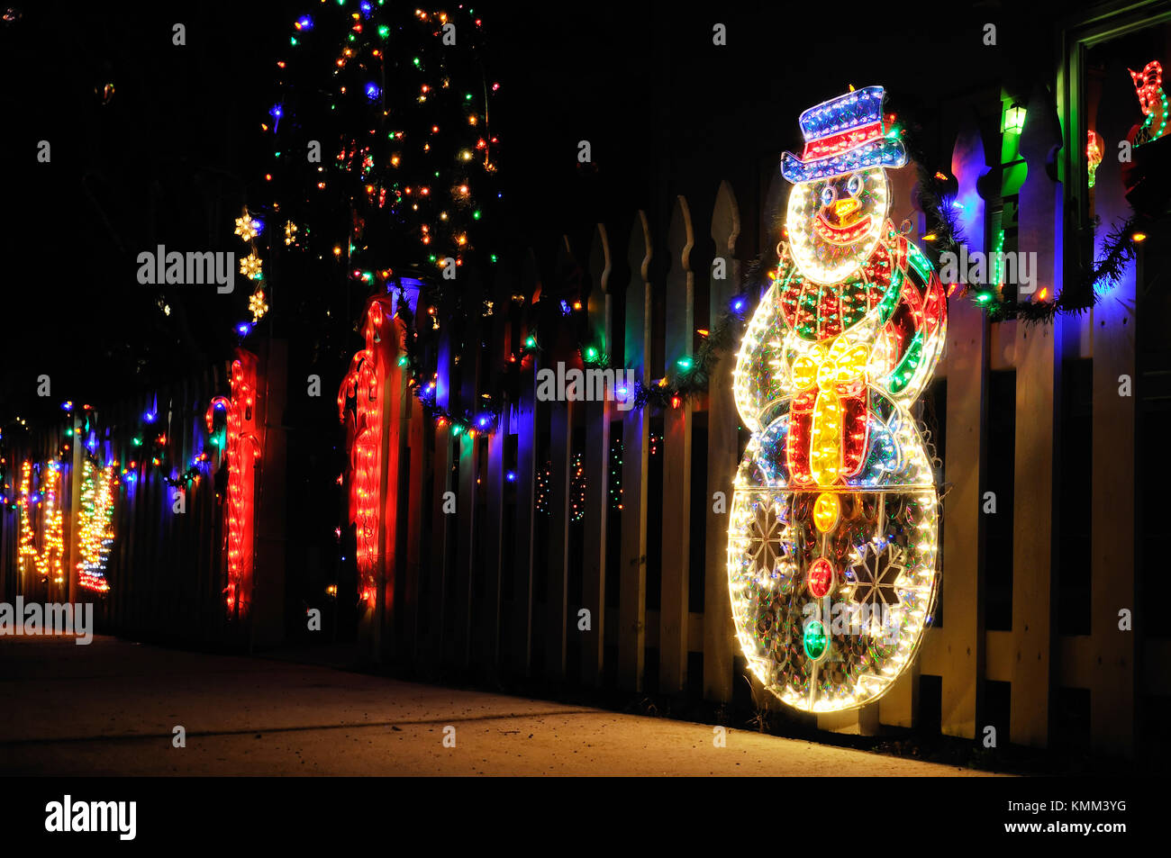 Christmas lights house outdoor night stock photos christmas christmas lights outdoor display with snowman and candy canes on garden fence colorful aloadofball Images