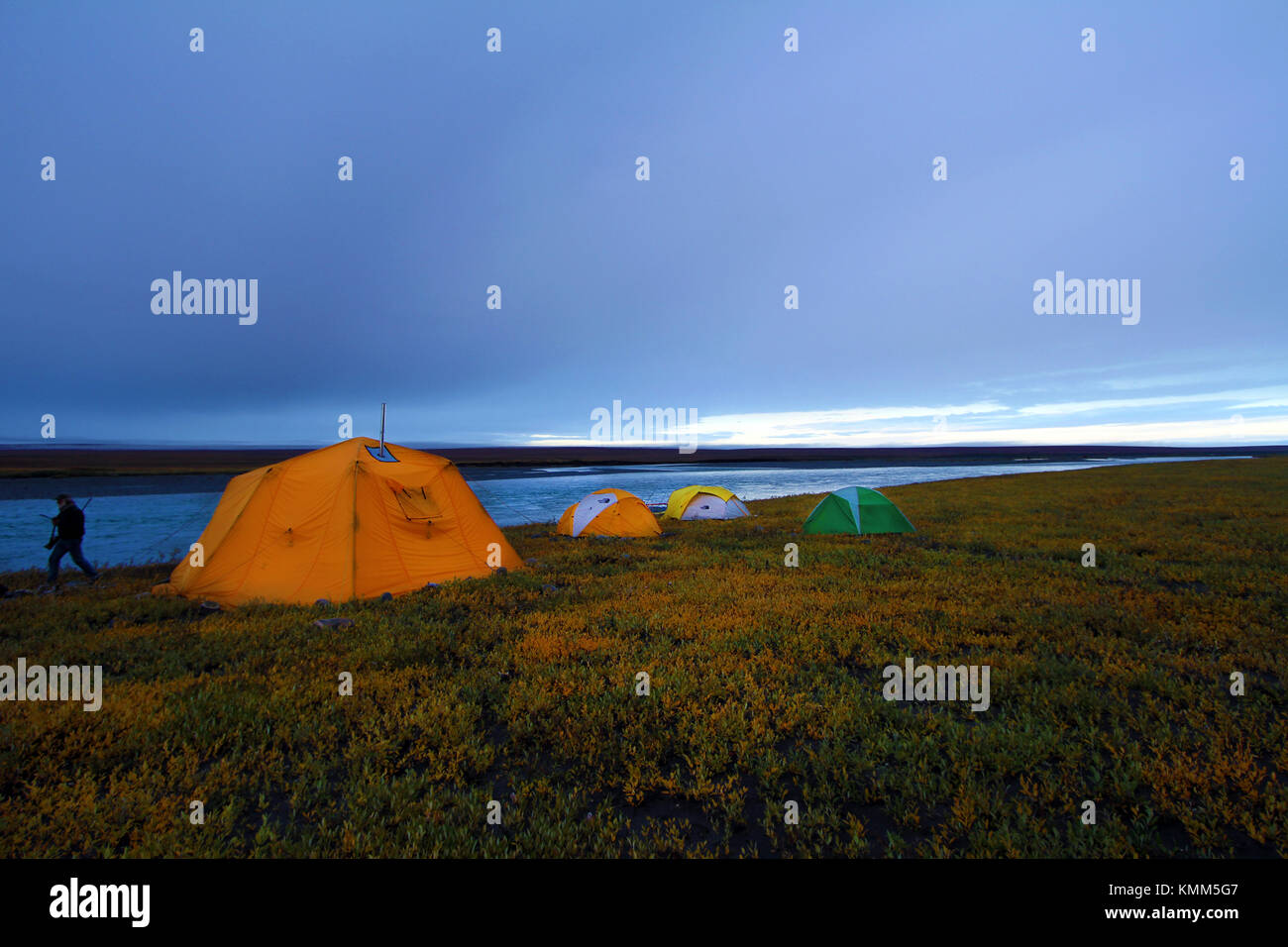 C&ers set up their tents by the Canning River at sunset at the Arctic National Wildlife & Campers set up their tents by the Canning River at sunset at the ...