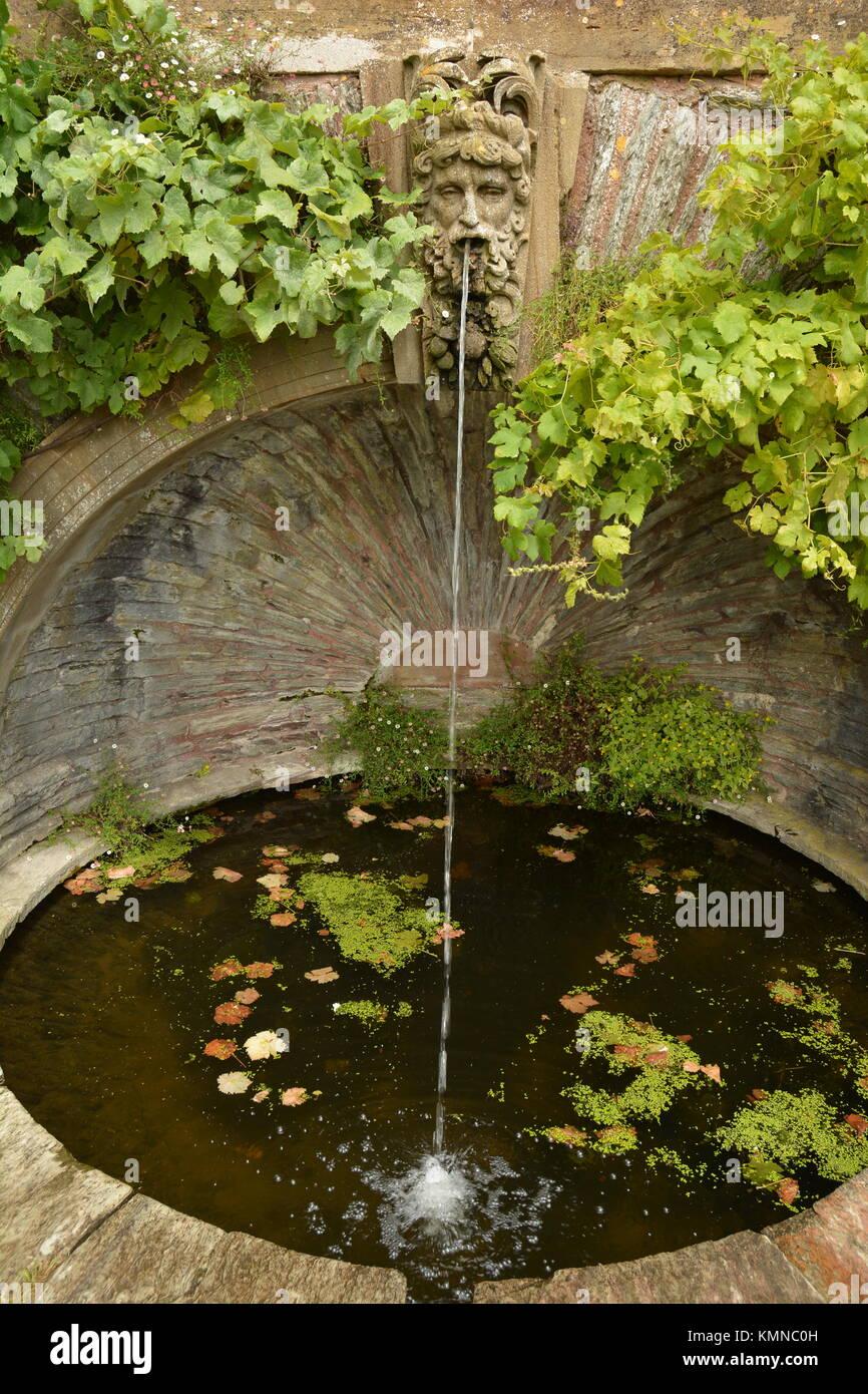 Circular pond with fountain stock photos circular pond for Circular garden ponds