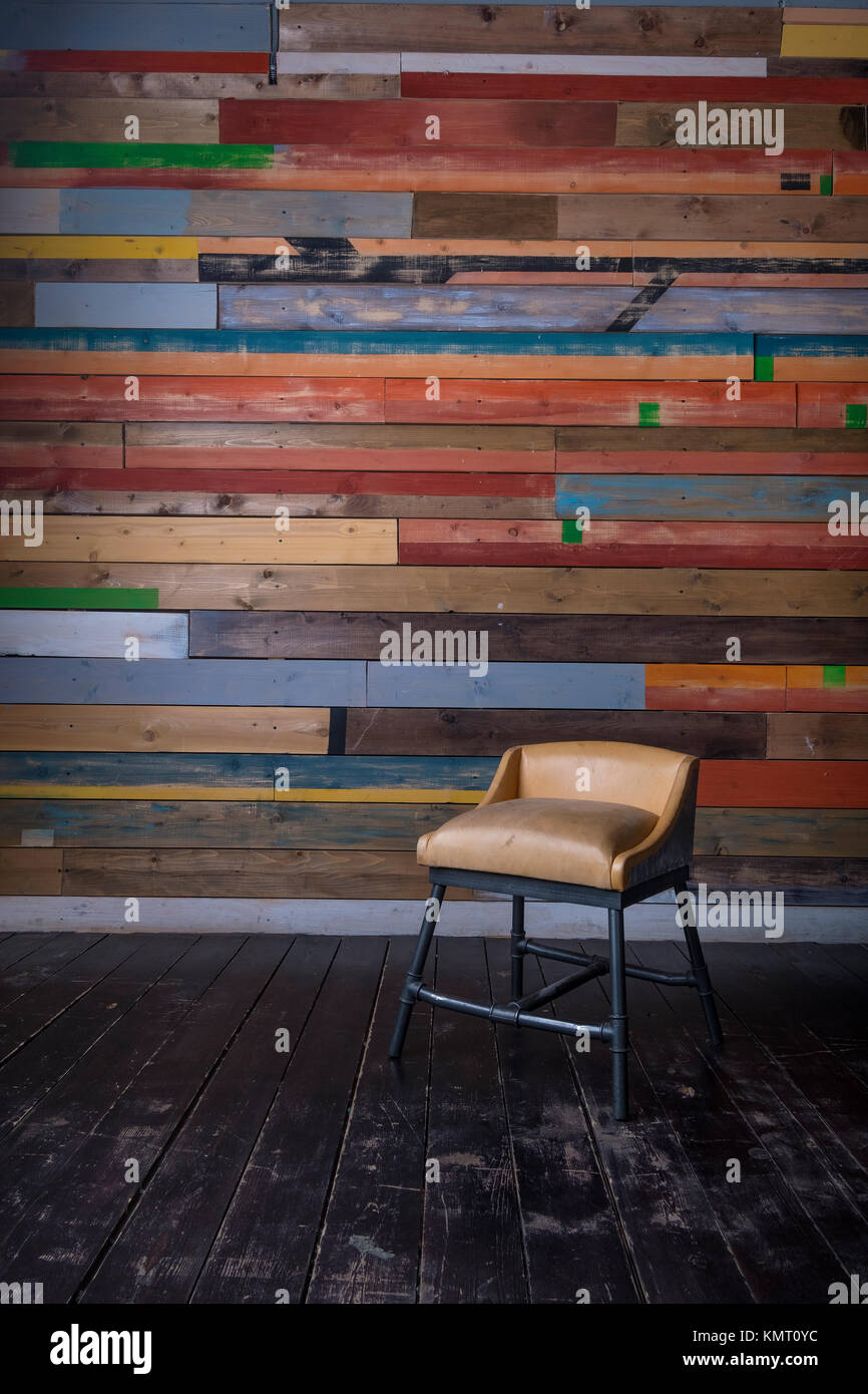 interior with multi colored wooden wall dark wooden floor and vintage tiny chair - Colored Wood Floor