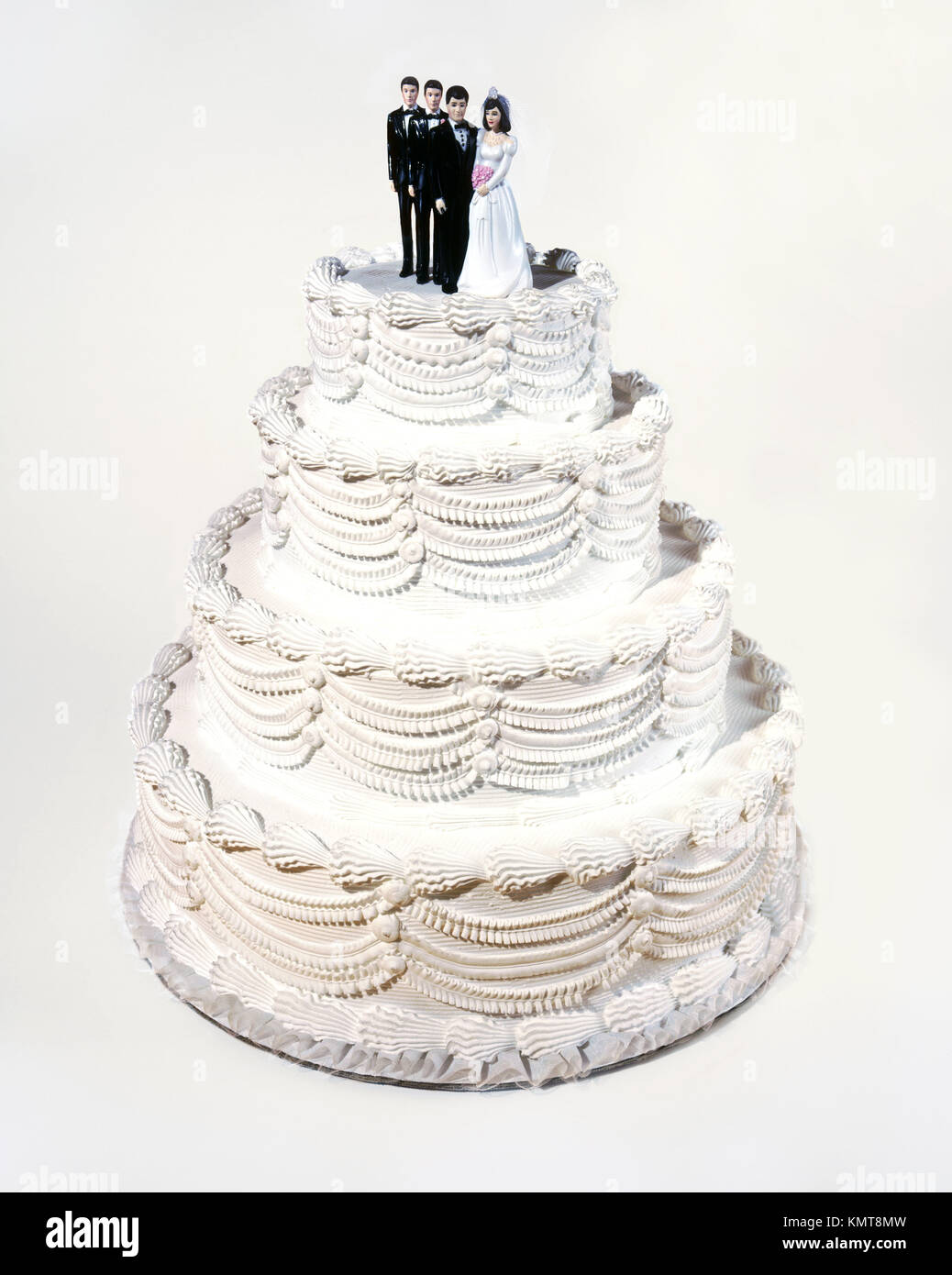 Wedding Cake With Couple And Two Best Men Stock Photo 167720137 Alamy