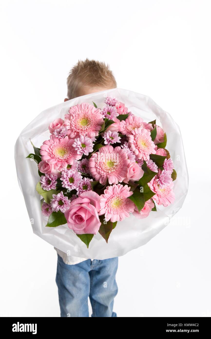 Little boy is hiding behind a bouquet of flowers Stock Photo ...
