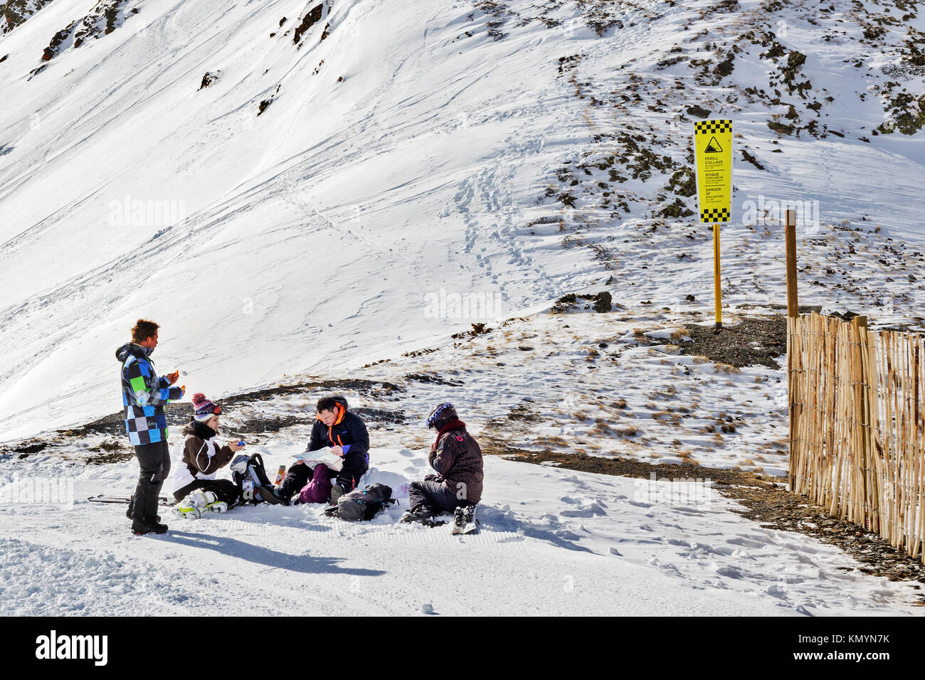 Pyrenees andorra february 11 2017 tourists at mountain top in pyrenees andorra february 11 2017 tourists at mountain top in ski resort skiers sit have a rest and watch the card pyrenees andorra winter s sciox Choice Image