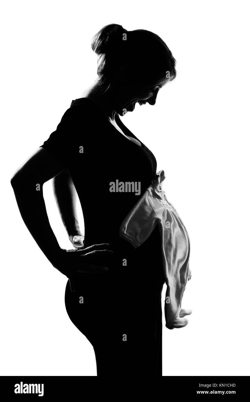 Beautiful Caucasian Pregnant Woman Baby Clothes In Silhouette On