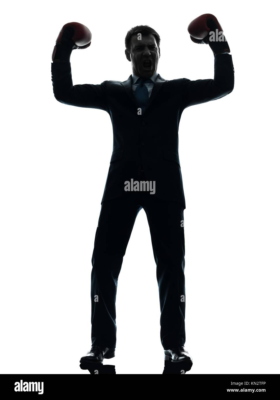 one caucasian businessman with boxing gloves in silhouette studio