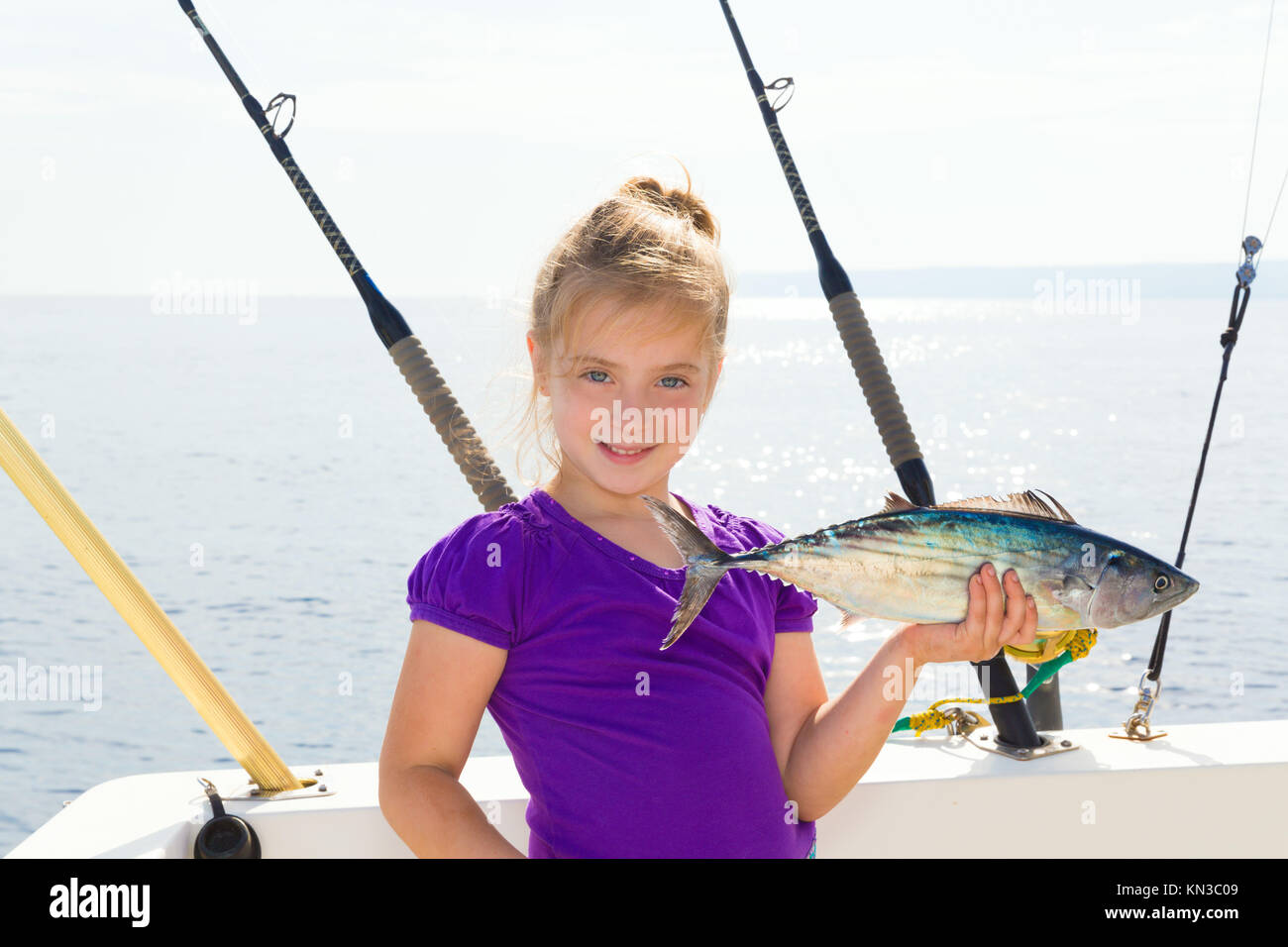 Boat fishing rod in mediterranean stock photos boat for Girl fishing pole