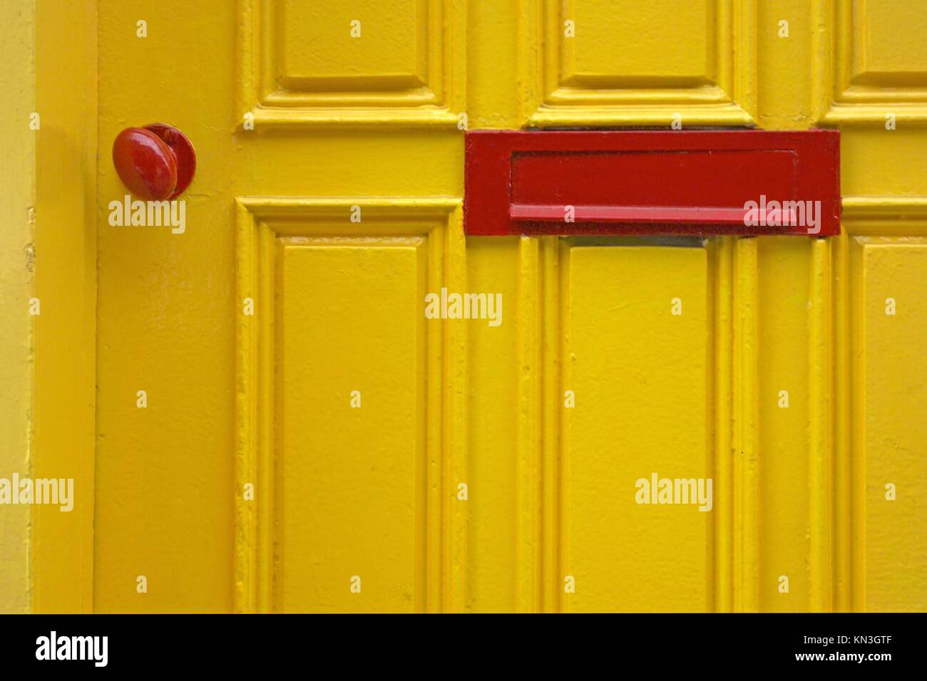 Extract of yellow with red door knob and letter drop Stock Photo ...
