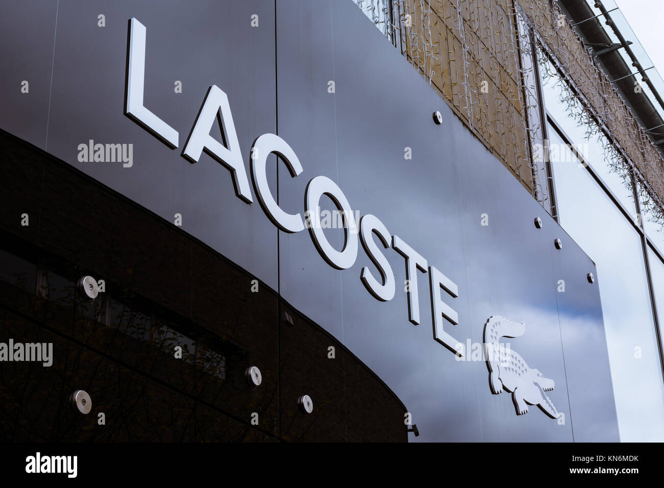 61b5339aaa0d1 Lacoste Logo at Metzingen Outlet Shopping Complex in Germany