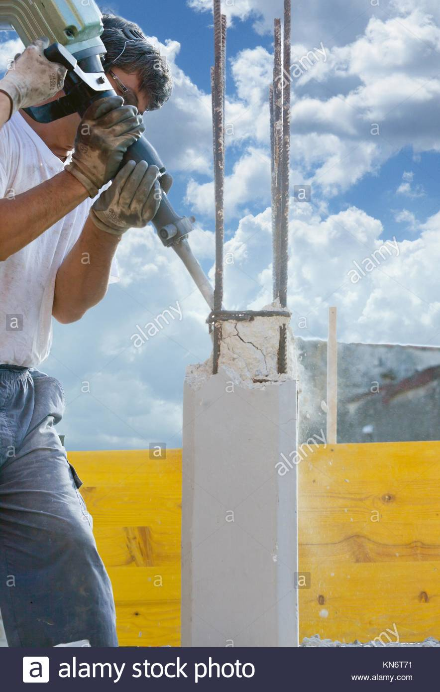 how to use a jackhammer to break cement