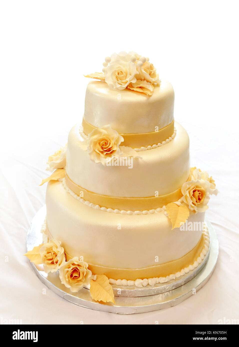 Wedding cake, on white (not isolated) background. 3-tiers covered in ...