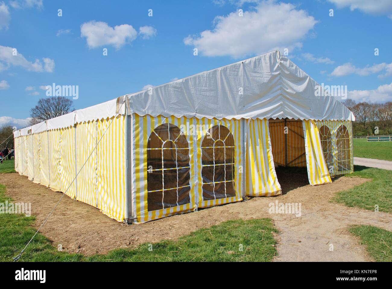 A yellow and white striped hospitality tent in Kent England & A yellow and white striped hospitality tent in Kent England Stock ...