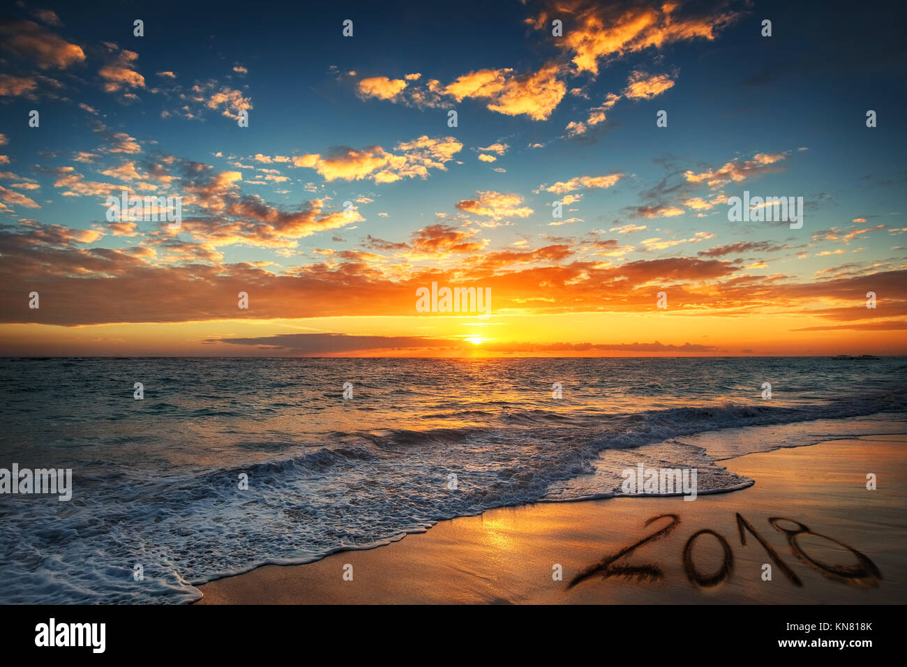 happy new year 2018 concept lettering on the beach sunrise over the beach punta cana