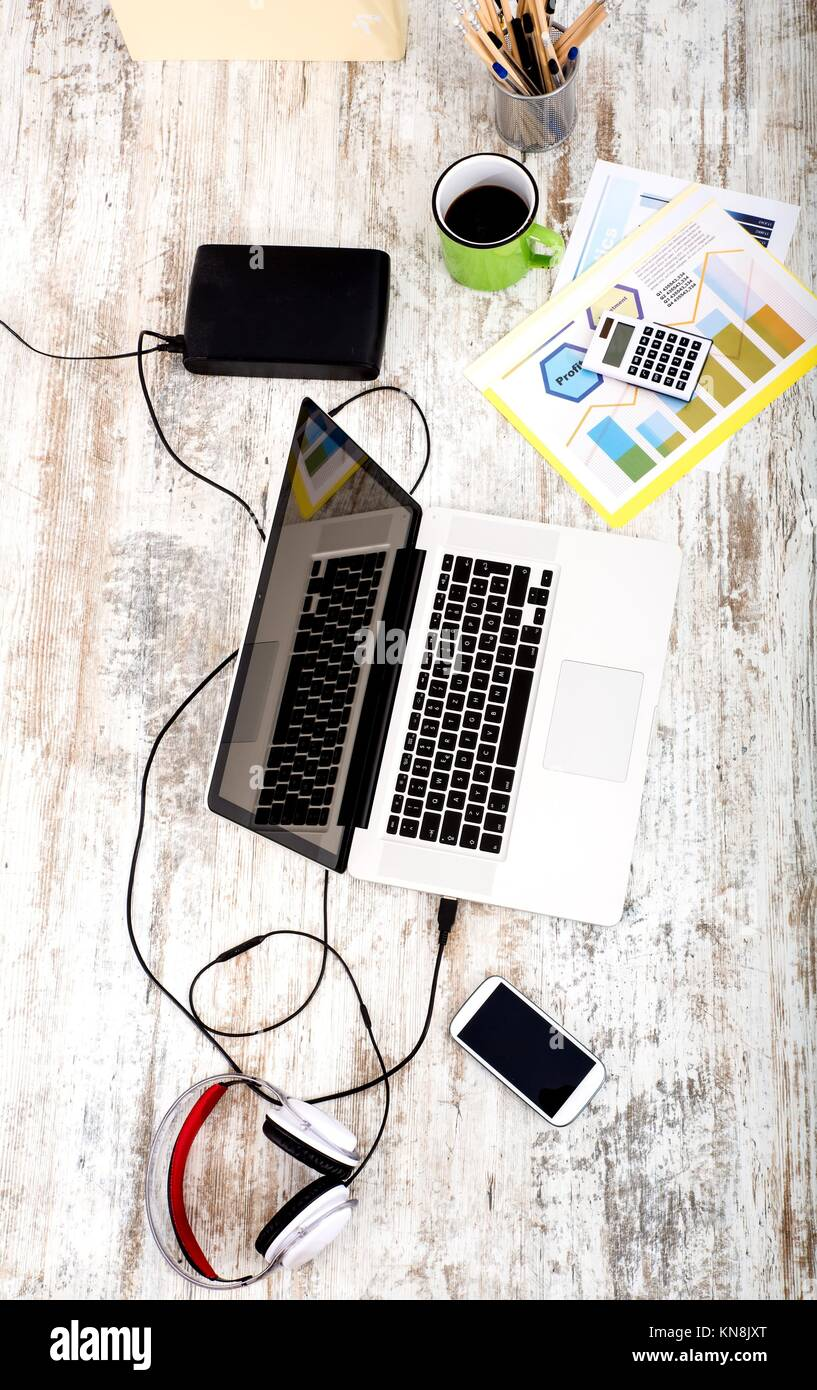 A modern home office setup on a wooden Table Stock Photo: 167991568 ...