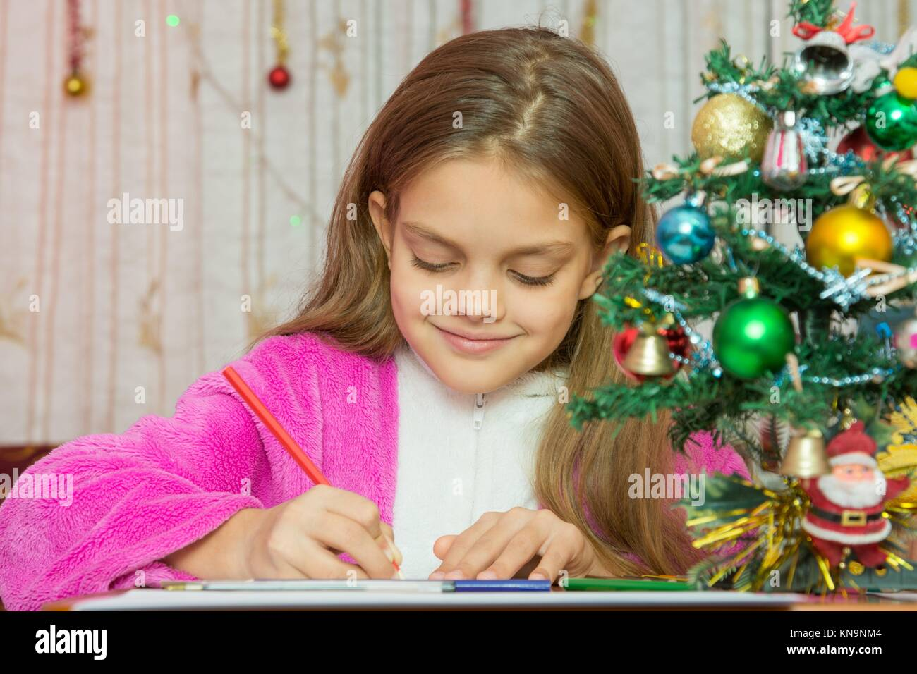 girl writes new year greetings