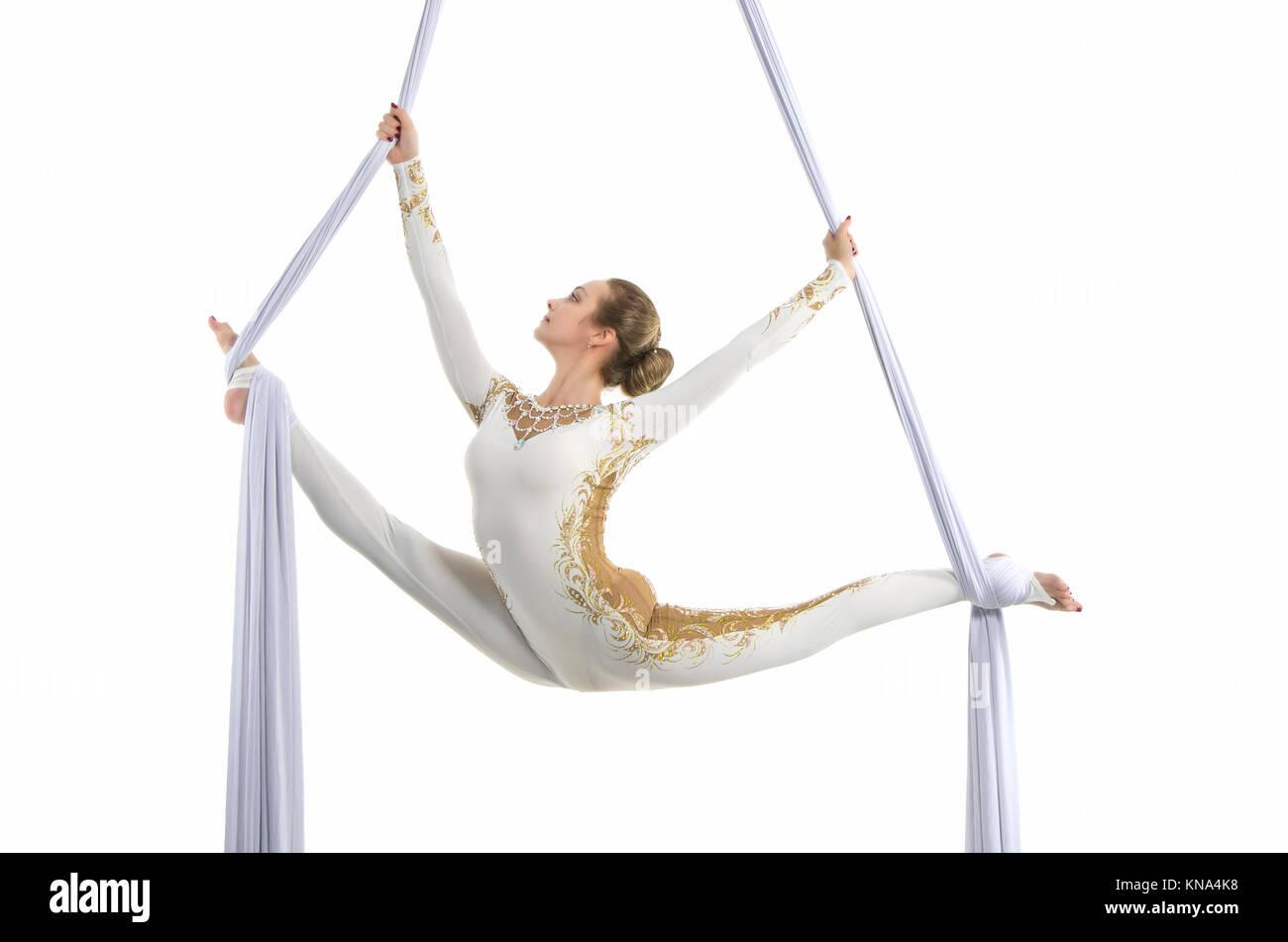pretty woman   aerialist performing aerial tricks on aerial silks  studio shooting on a white aerial tricks stock photos  u0026 aerial tricks stock images   alamy  rh   alamy