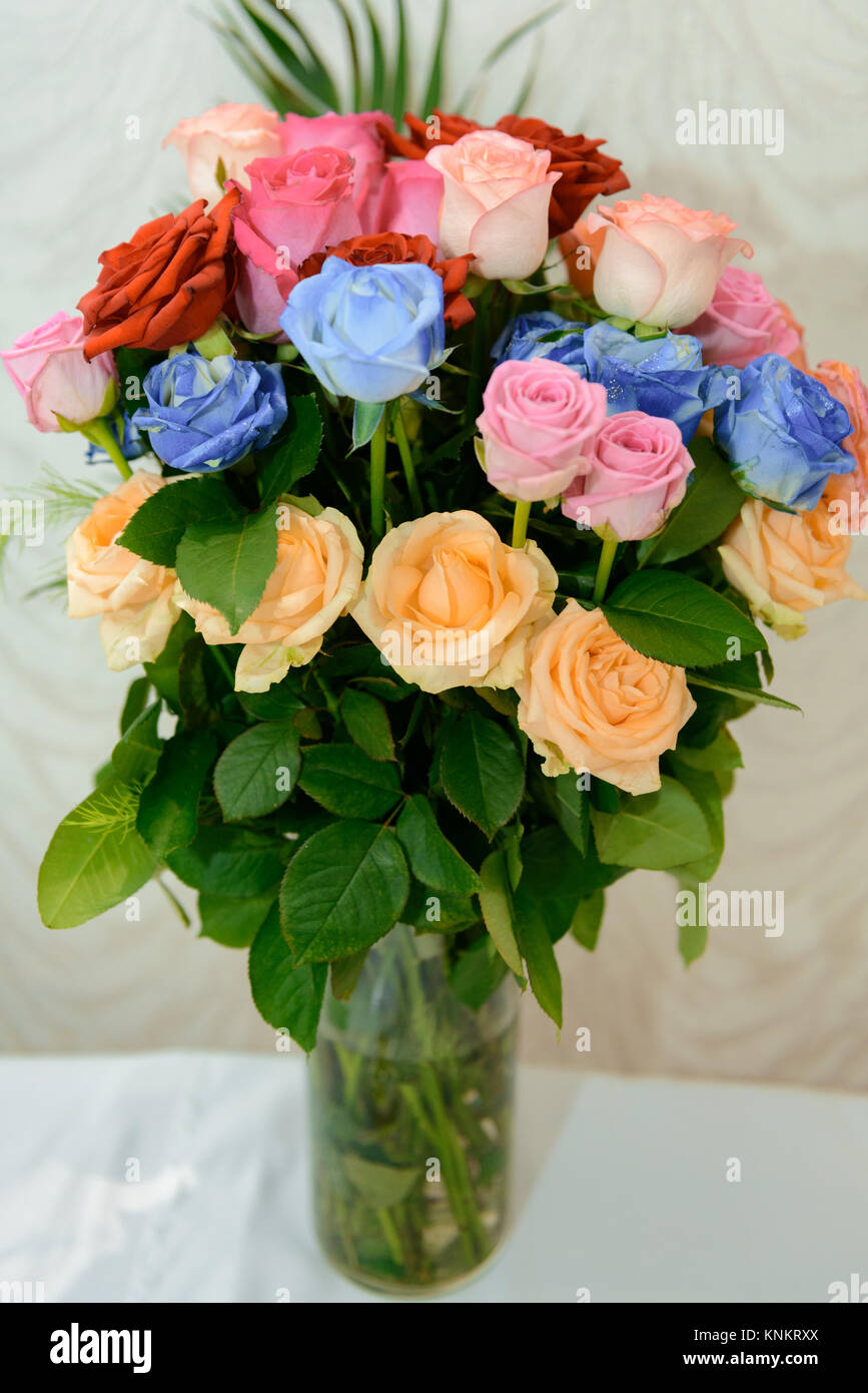 Beautiful bouquet of bright flowers in color vase, on bright Stock ...