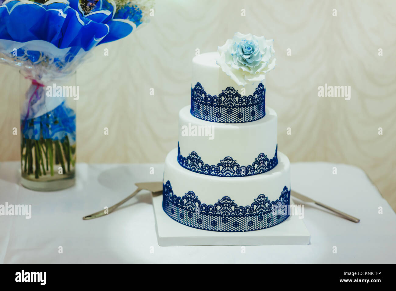 Blue wedding cake decorated with white flowers closeup of blue and blue wedding cake decorated with white flowers closeup of blue and white wedding cake at reception izmirmasajfo Images