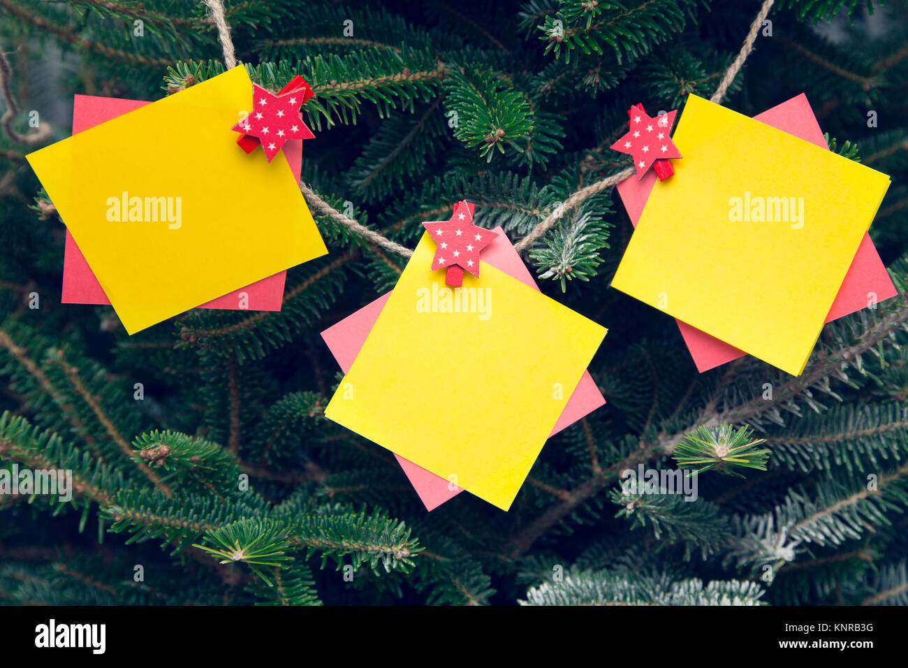 a garland made of pieces of colored paper on a thread christmas or new year background space for your text or product display