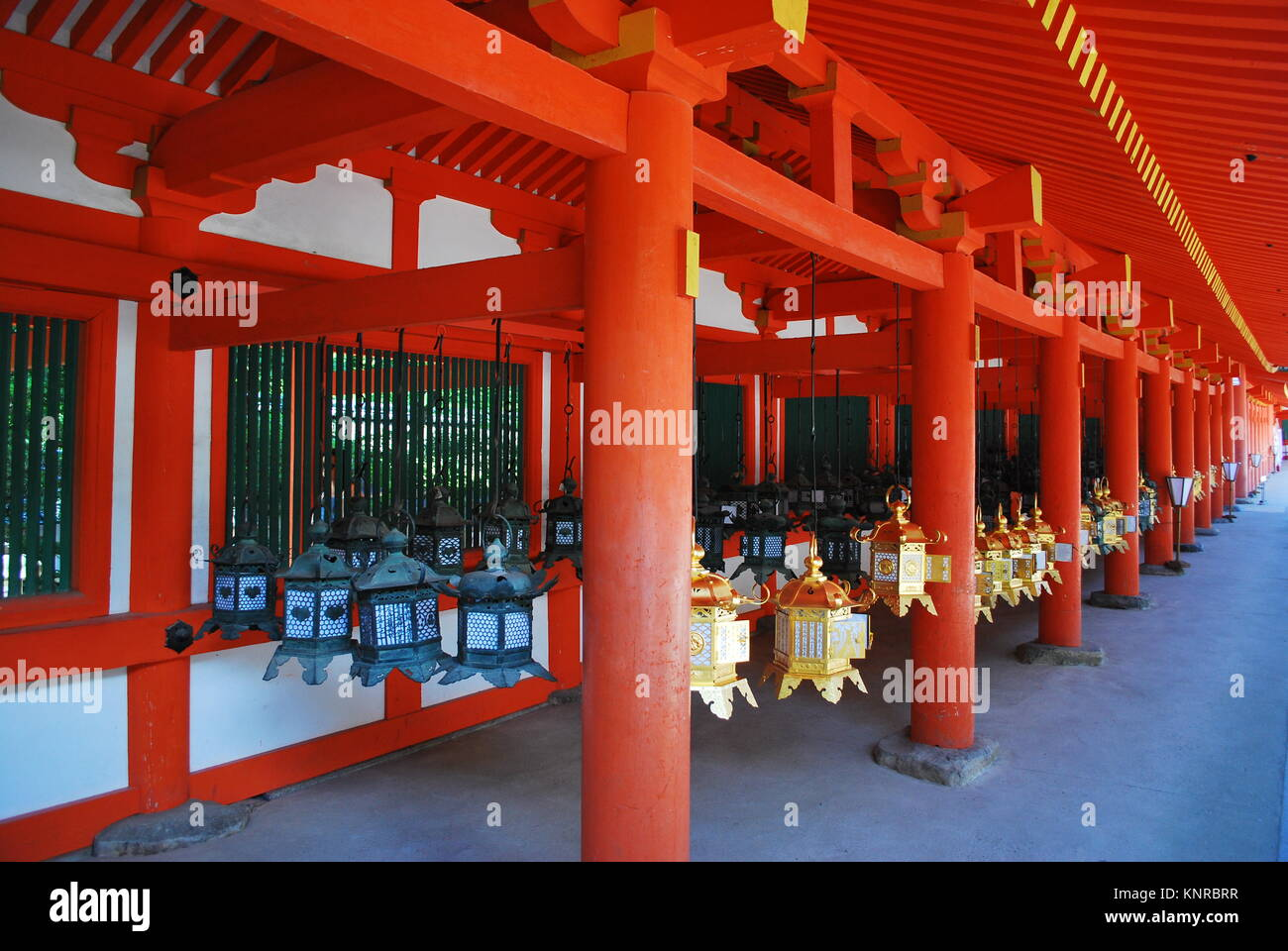 Metal traditional lanterns hanging outside a shrine in nara metal traditional lanterns hanging outside a shrine in nara symbol of religion faith and worship biocorpaavc Images