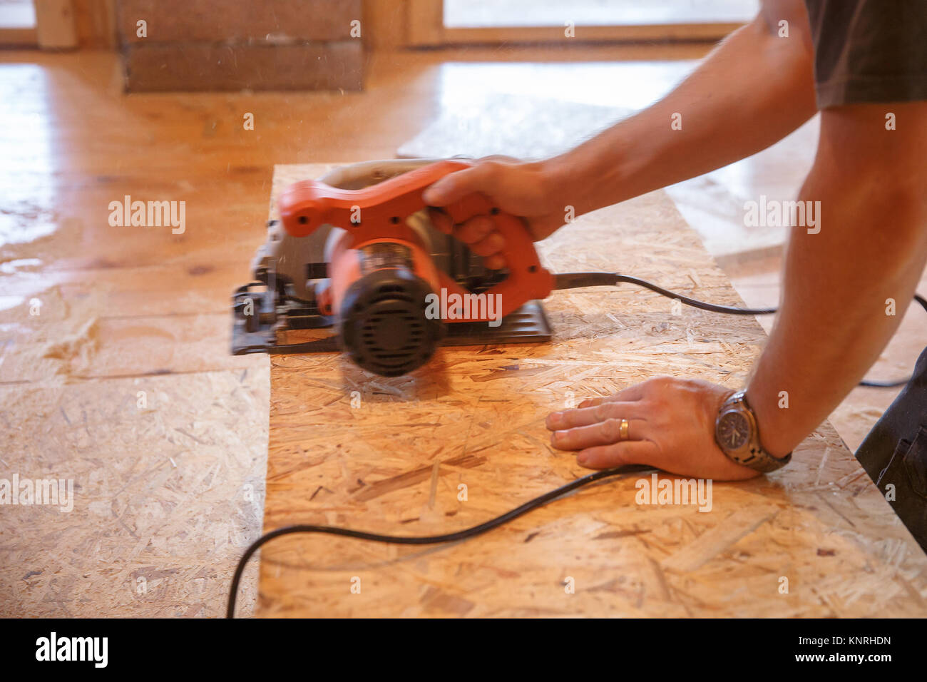 Worker Using Professional Saw Cutting The Flakeboard Osb Diy