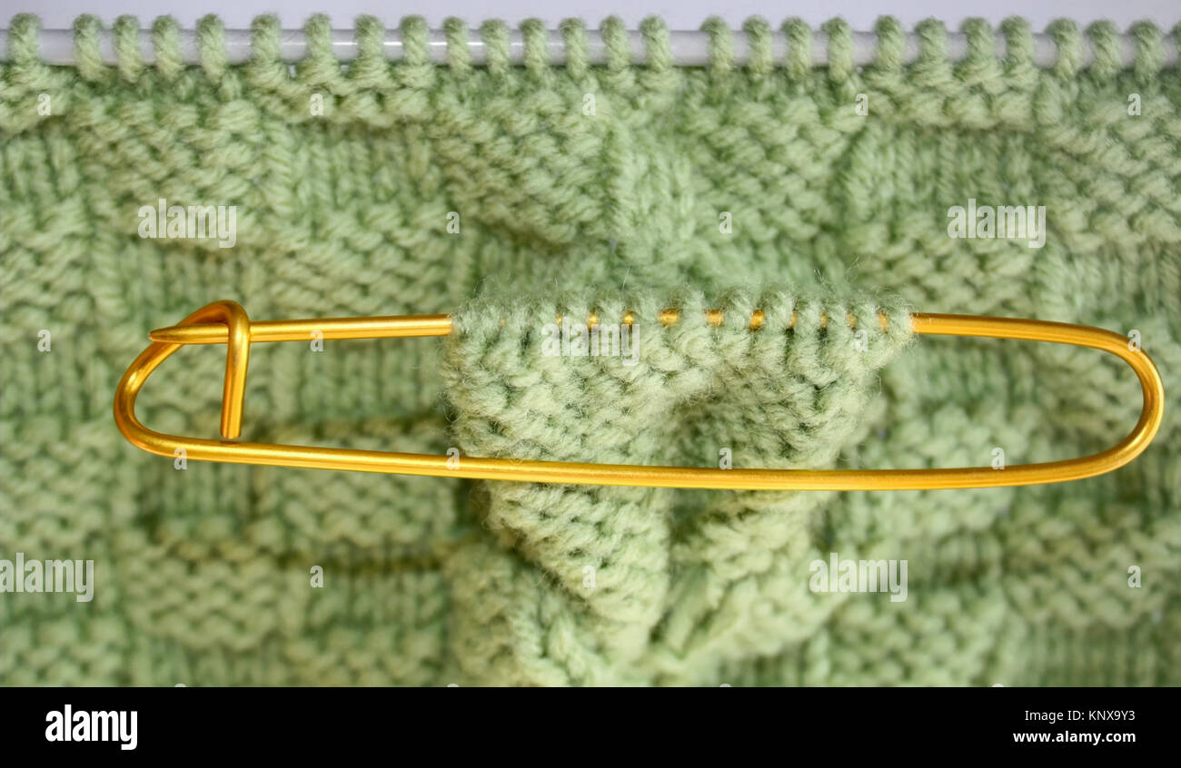 Basket Weave Pattern Knitted On Knitting Needles In Sage Green Color