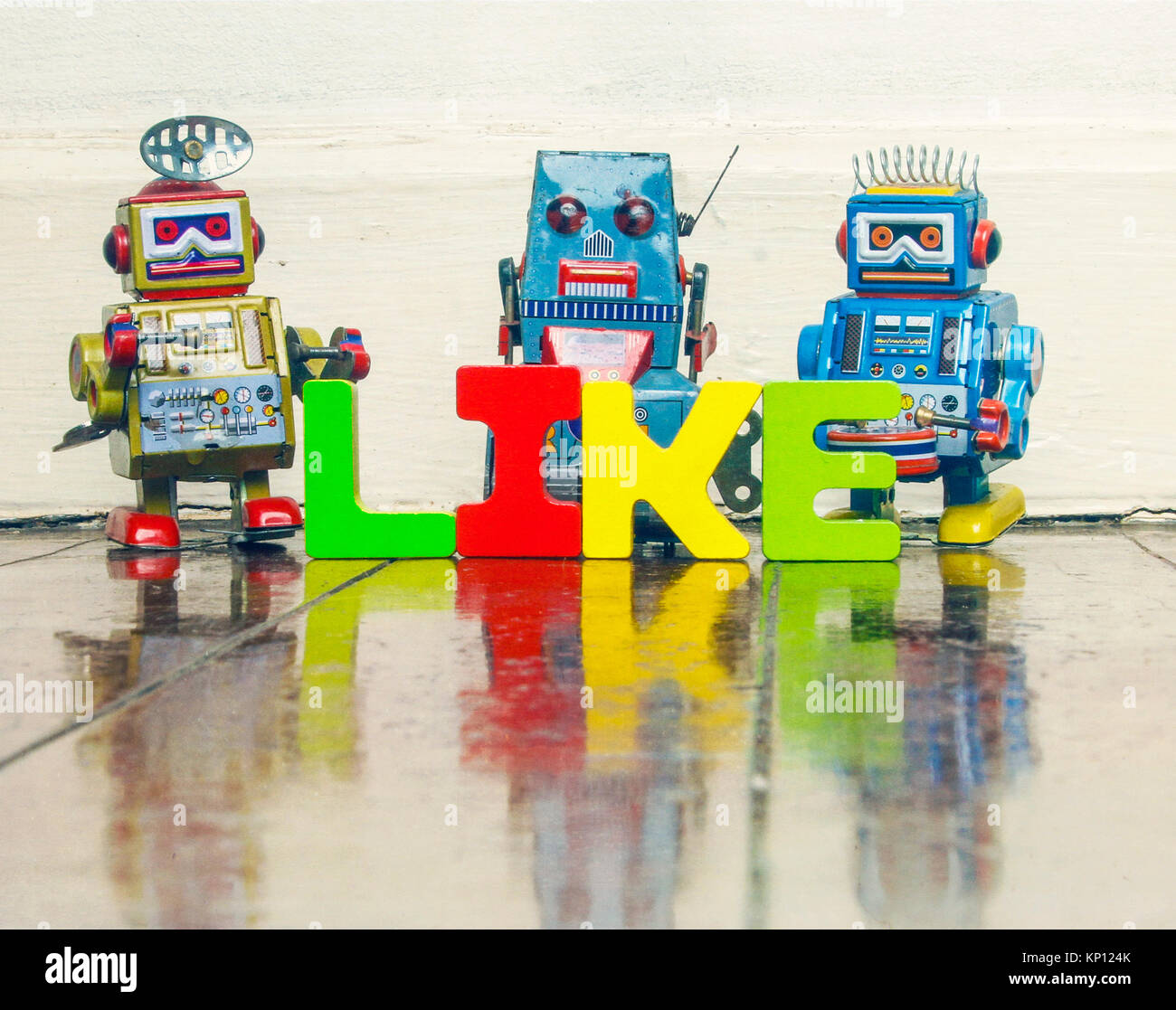 The Word Like With Retro Robot Toys On Old Wooden Floor With Stock