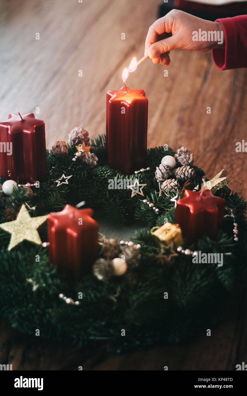 Lighting The First Candle On Advent Wreath Four Weeks Before Christmas As Traditionally In Switzerland Closeup Details