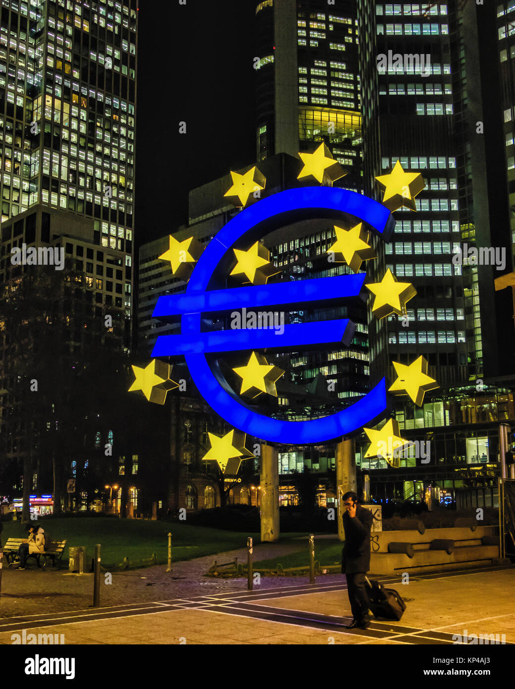 Frankfurtgermanyilluminated Euro Symbol In Front Of The Euro Tower
