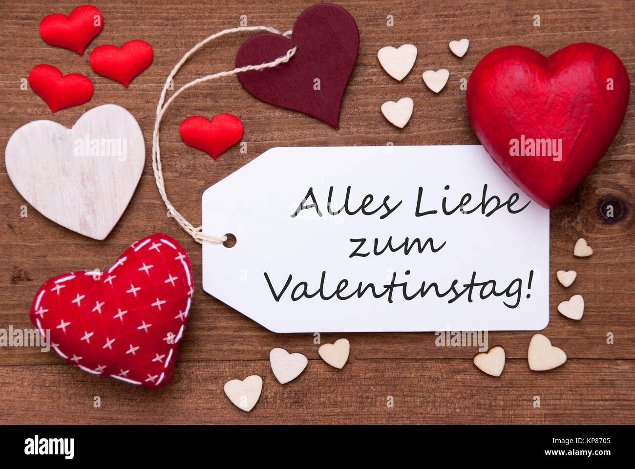Label With Red Textile Hearts On Wooden Background. German Text Alles Liebe  Zum Valentinstag Means Happy Valentines Day. Retro Or Vintage Style