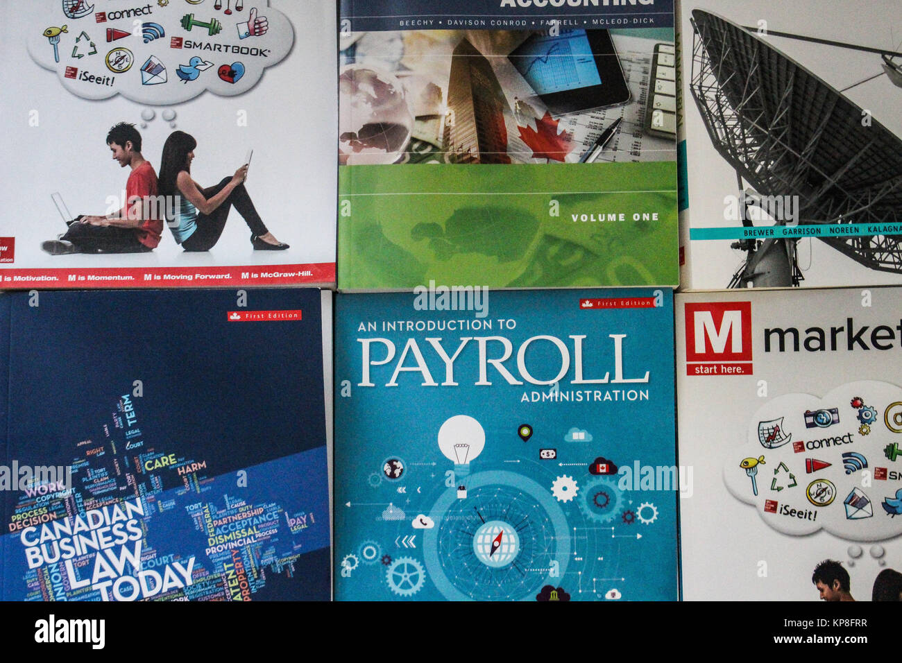 mcgraw hill textbooks for business programs lined up showing a stock