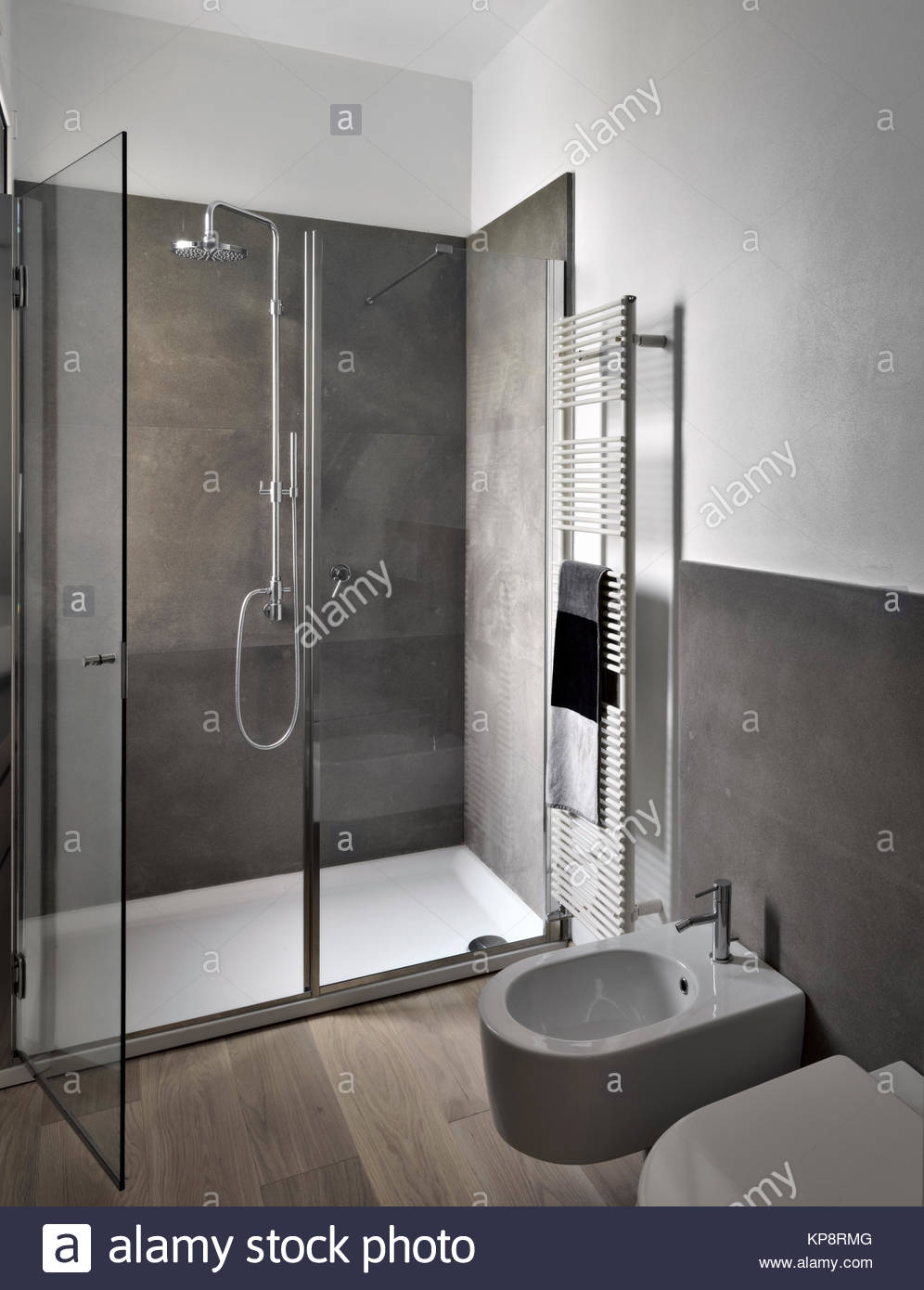 interior view of modern bahtroom with glass shower cubicle and wood ...