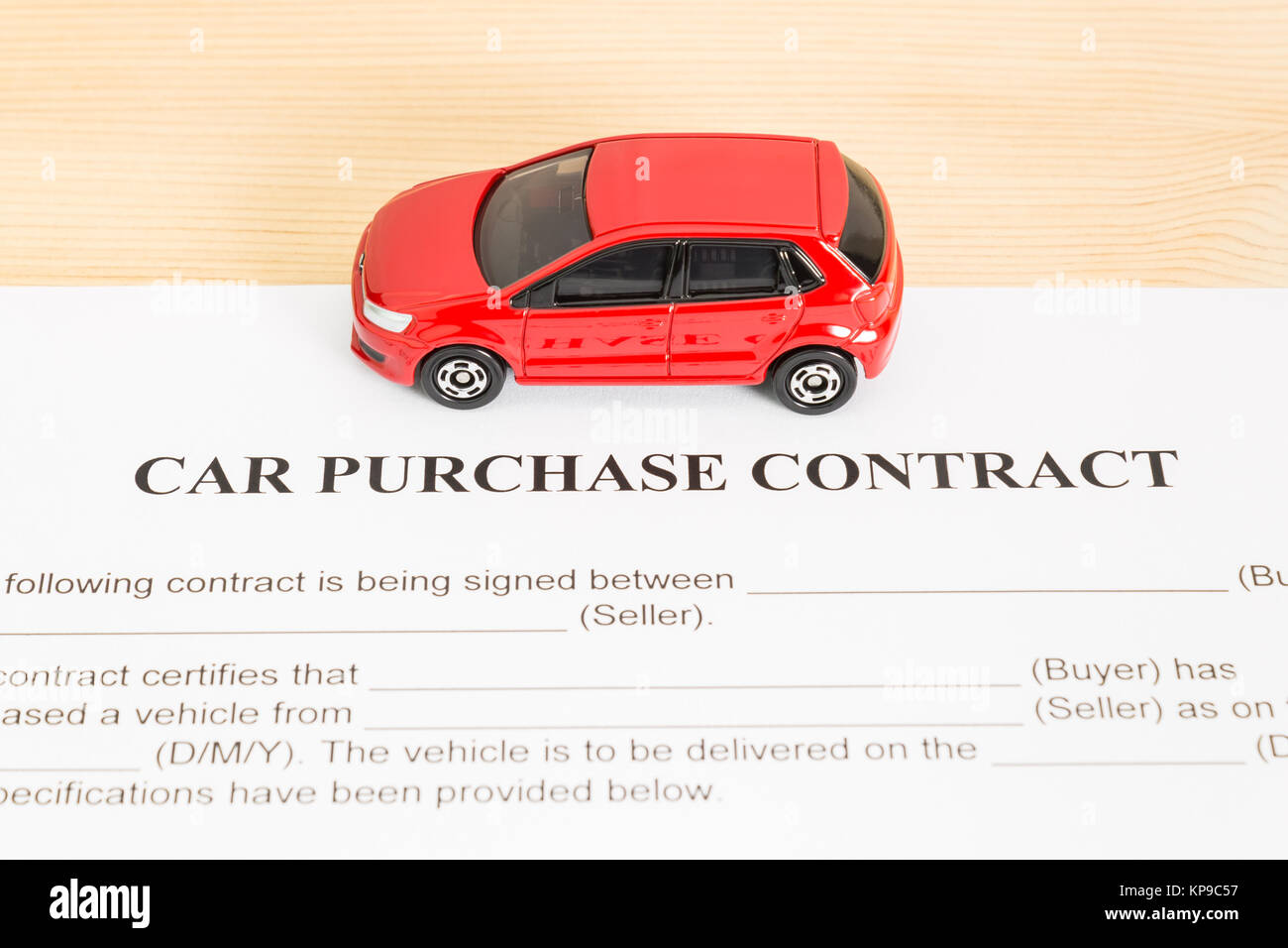 car purchase contract with red car on center stock photo 168622867