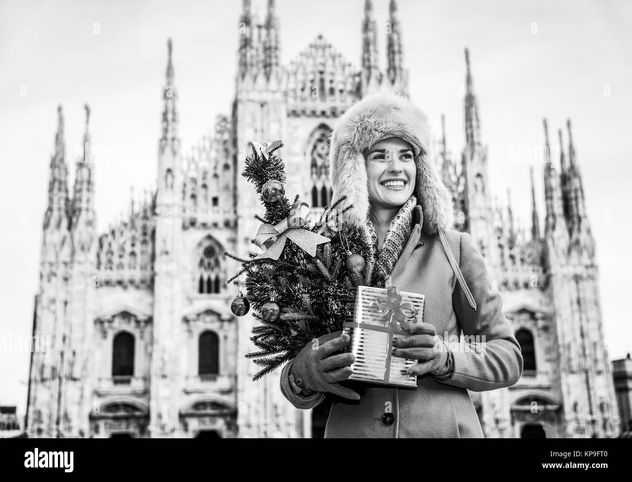 Fun Christmas trip to Milan, Italy. happy modern traveller woman in ...