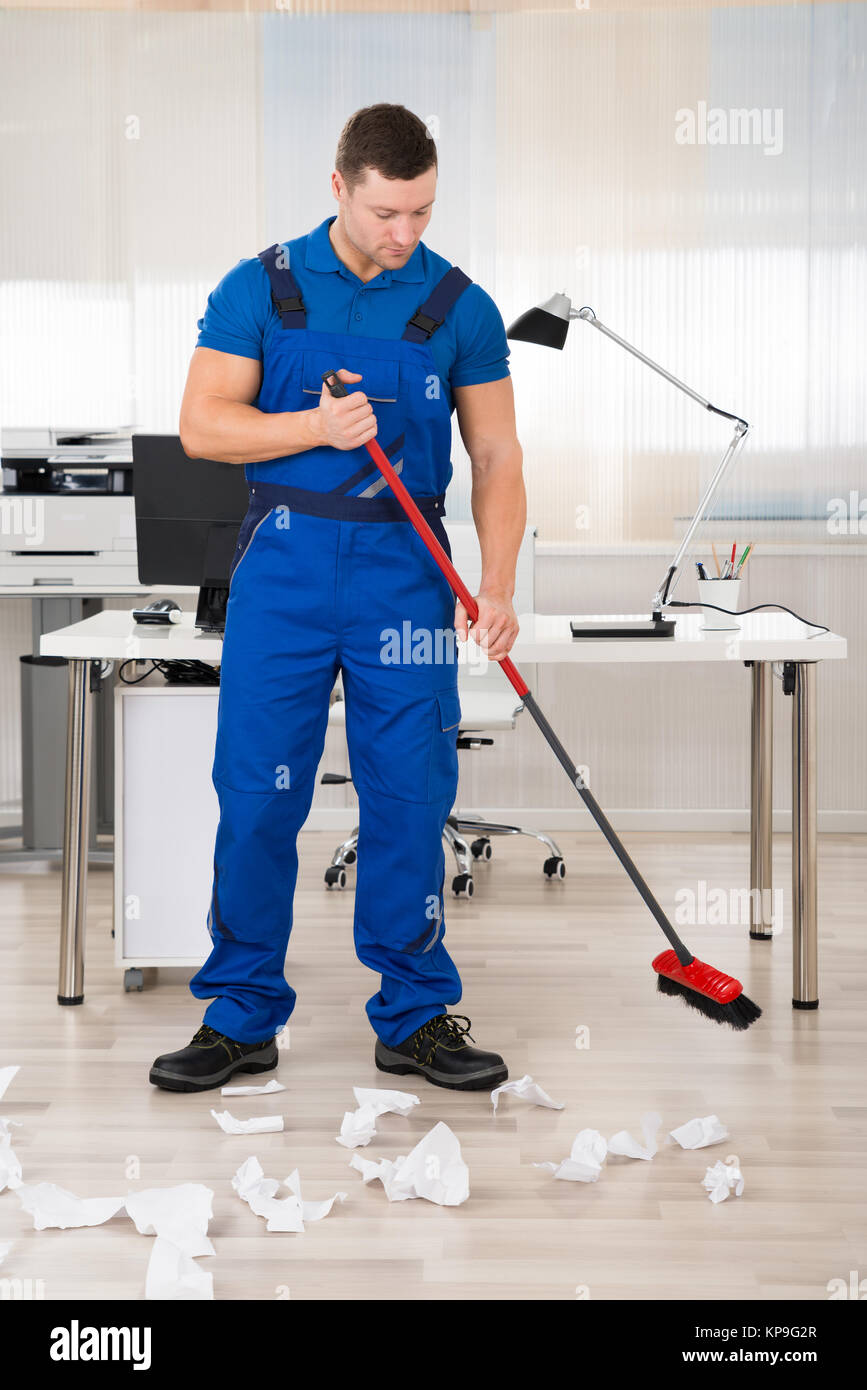 Man with broom house stock photos