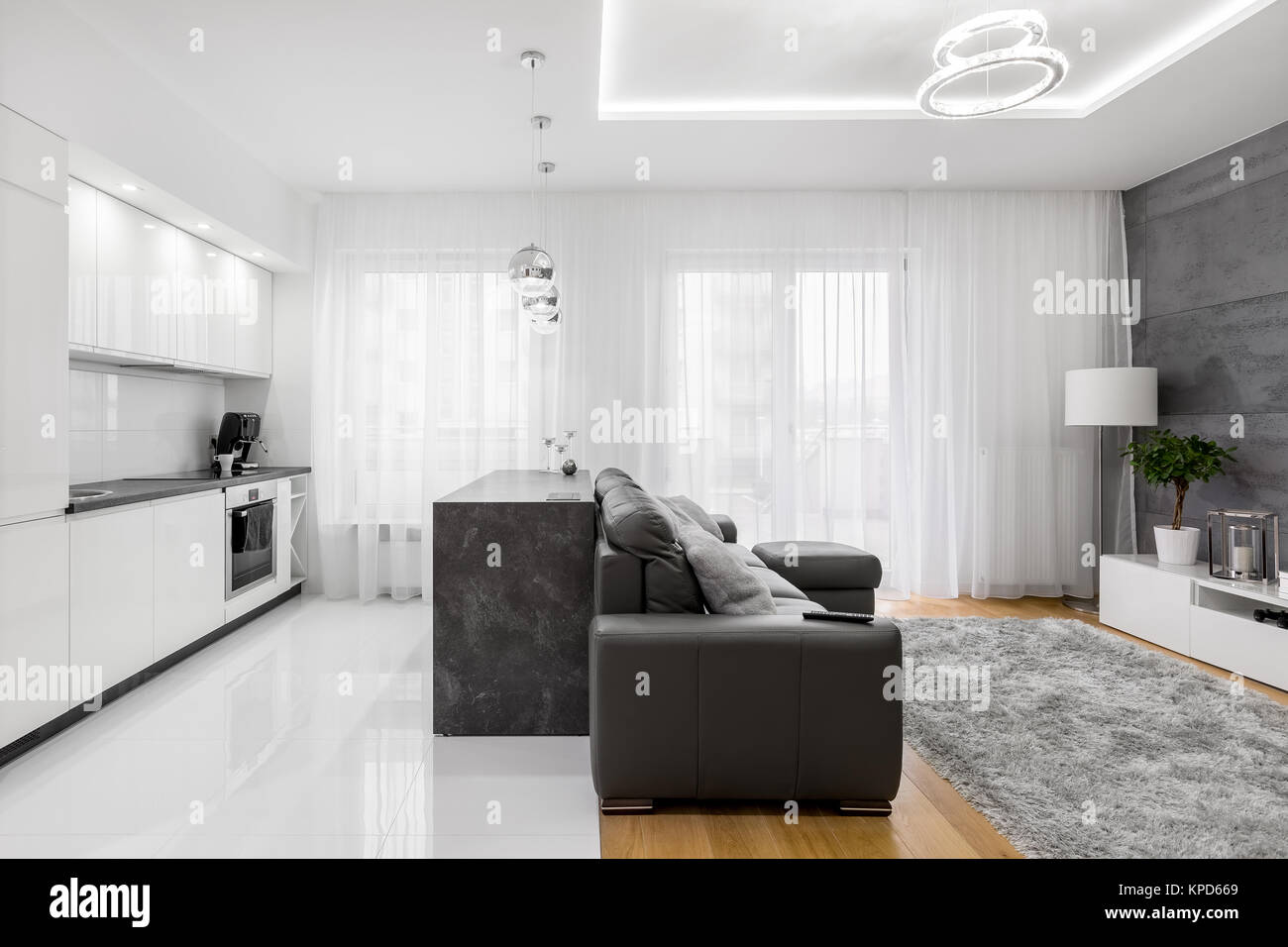 white kitchen and living room in modern luxurious apartment stock
