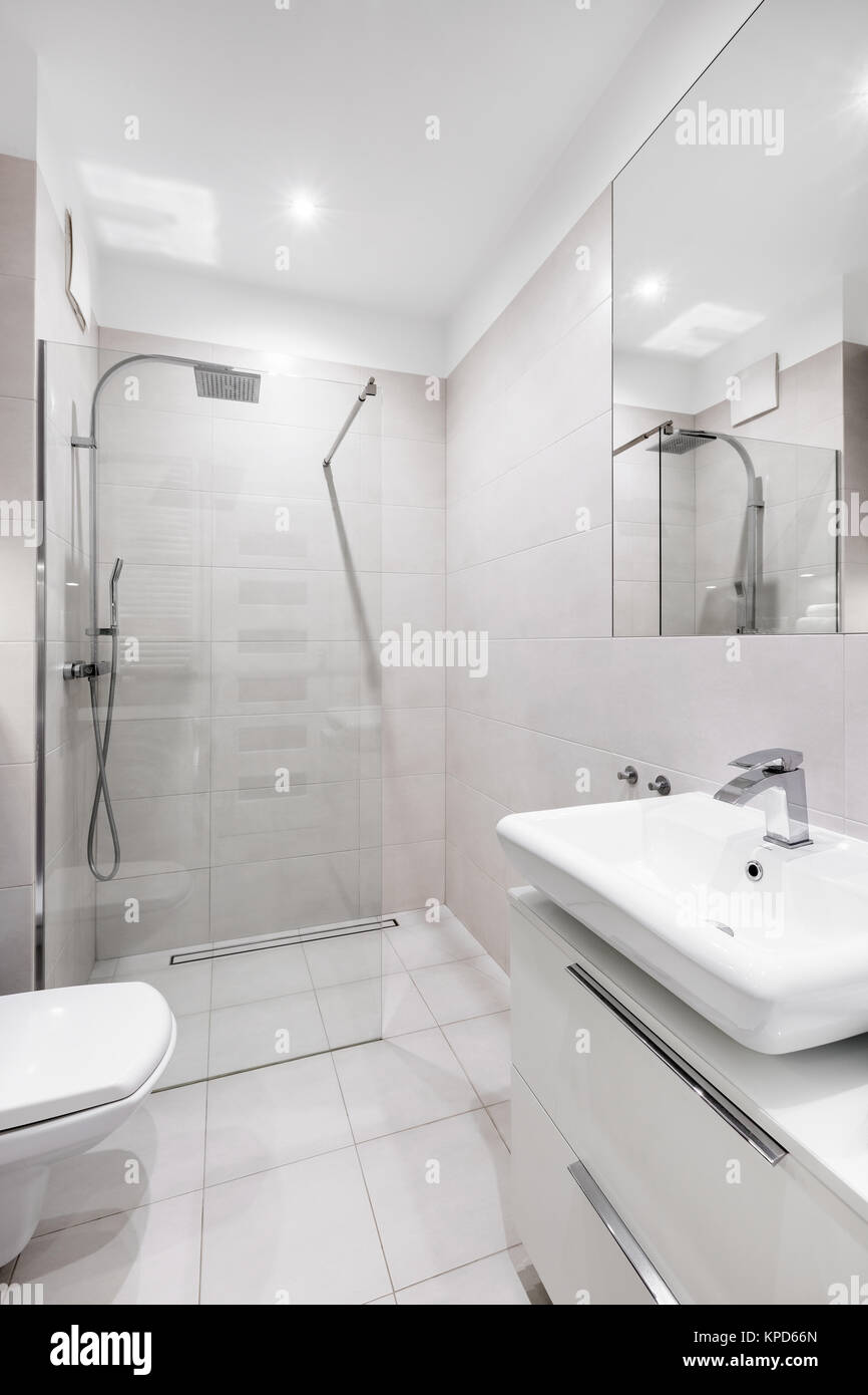 Bright, modern, white bathroom with tiled walk-in shower Stock Photo ...
