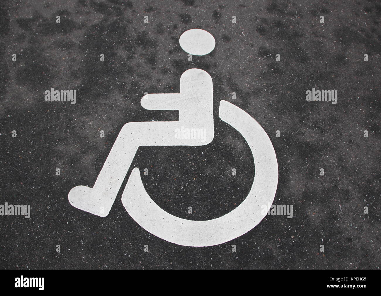 White Handicap Disabled Toilet Sign On Black Wood