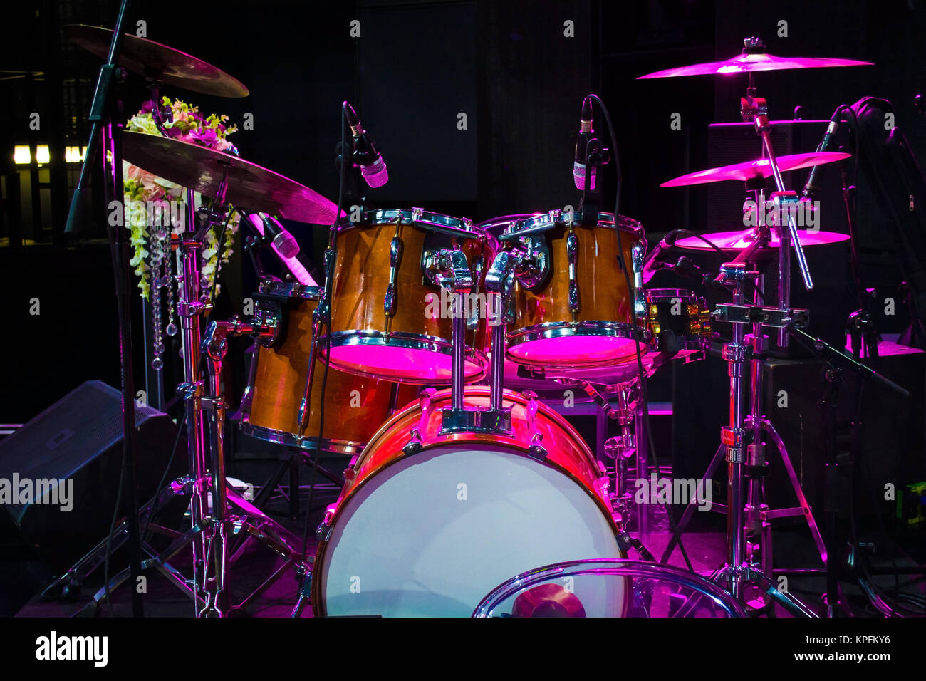 Drum Set On Stage And Magenta Light Background Empty Stage With