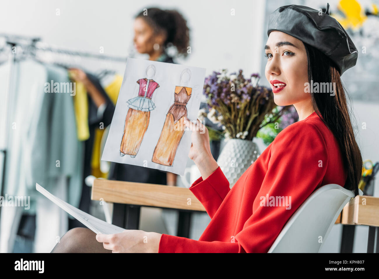 Asian Clothing Designers | Asian Fashion Designer With Sketches Stock Photo 168795207 Alamy