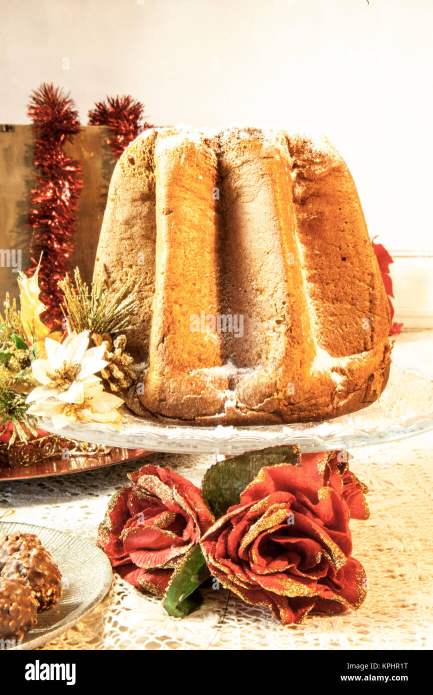il pandoro a typical italian christmas dessert on a beautiful table with decorations - Italian Christmas Table Decorations