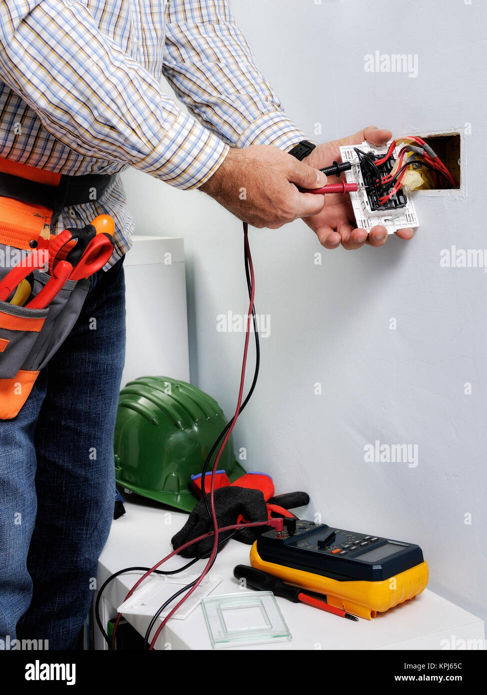 Electrician at work on switches and sockets of a residential Stock ...
