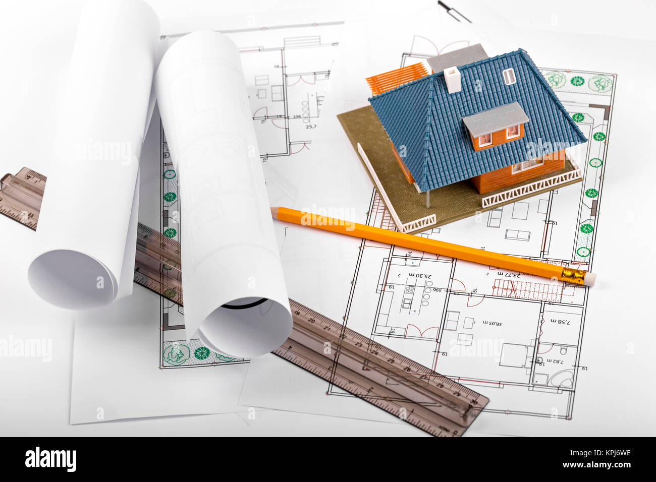 Architect model housing development stock photos architect model housing development new real estate project house on blueprints stock image malvernweather Image collections