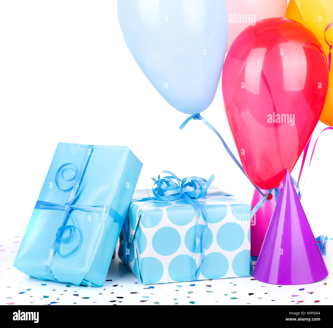 blue birthday gifts with balloons and party hats on a white stock