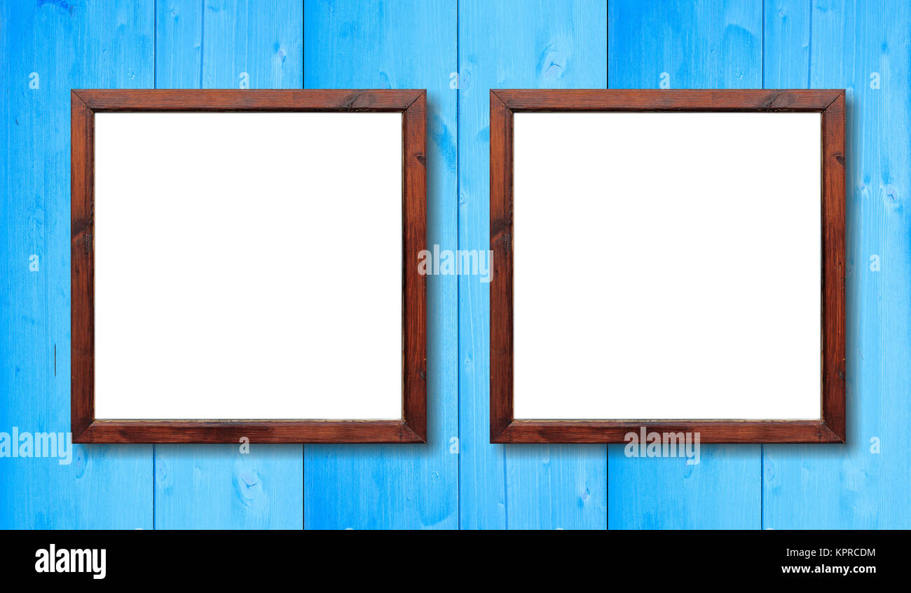 Two blank wooden frames on the wall. White inside and light blue ...