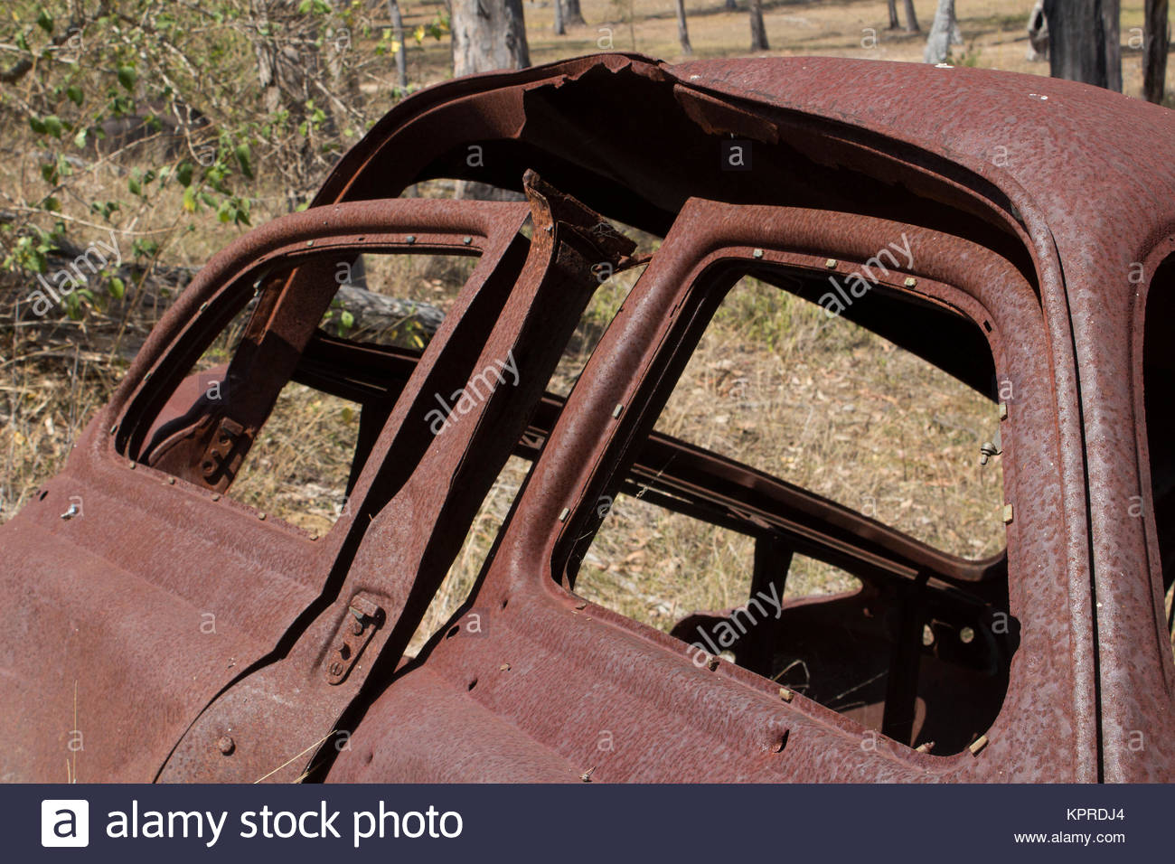 The doors of a rusty old abandoned car in the Australian bush & The doors of a rusty old abandoned car in the Australian bush ...